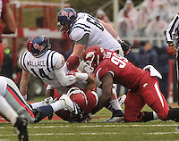 NWA Media/Michael Woods --11/22/2014-- w @NWAMICHAELW...Ole Miss quarterback Bo Wallace fumbles the ball as he is hit by Arkansas defenders Darius Philon and Brandon Lewis during the 2nd quarter of Arkansas 30-0 win over Ole Miss during Saturdays game at Razorback Stadium.