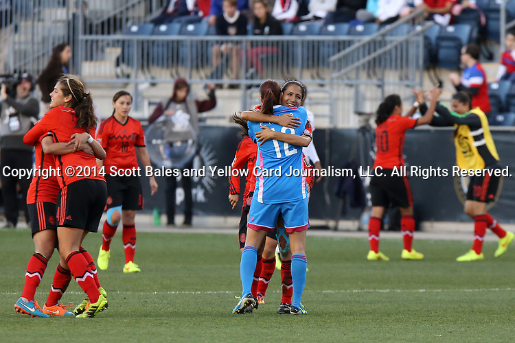 26 October 2014: Mexico players celebrate the win and World Cup qualification after the game. The Trinidad & Tobago Women's National Team played the Mexico Women's National Team at PPL Park in Chester, Pennsylvania in the 2014 CONCACAF Women's Championship Third Place game. Mexico won the game 4-2 after extra time. With the win, Mexico qualified for next year's Women's World Cup in Canada and Trinidad & Tobago face playoff for spot against Ecuador.