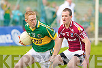 Kerry's Colm Cooper and Galway's Damien Burke.