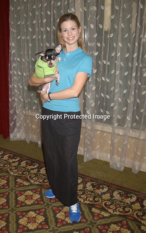 ..Stephanie Gatschet and her dog Chi Chi ....at Animal Haven's 36th Annual Going Home Luncheon ..on October 19, 2003 at the Sheraton LaGuardia East Hotel in Flushing New York. Photo by Robin Platzer, Twin Images