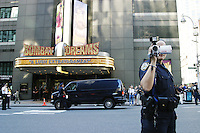 "NYPD officers continually film protesters during the Republican National Convention in New York City, here as hundreds gather in Times Square on August 29, 2004 as part of a ""Mouse Bloc"" to protest the presence of Republican delegates on Broadway."
