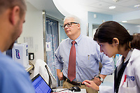 "Dr. Allan Ropper speaks with residents and fellows while going on rounds to perform neurological examinations of patients at the Neuroscience Intensive Care Unit at Brigham and Women's Hospital in Boston, Massachusetts, on Wed., Sept. 24, 2014. Ropper is the Executive Vice Chair of Neurology at Brigham and a professor at Harvard Medical School specializing in neurology. On September 30, Ropper's recent book ""Reaching Down the Rabbit Hole: A Renowned Neurologist Explains the Mystery and Drama of Brain Disease"" will be published by St. Martin's Press."