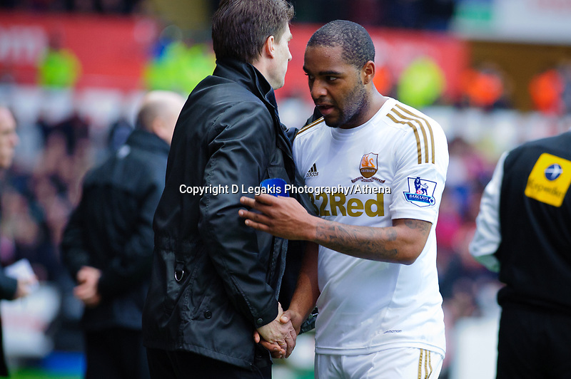 Sunday, 23 November 2012<br /> <br /> Pictured: Micheal Laudrup and Kemmy Augustien of Swansea City<br /> <br /> Re: Barclays Premier League, Swansea City FC v Manchester United at the Liberty Stadium, south Wales.