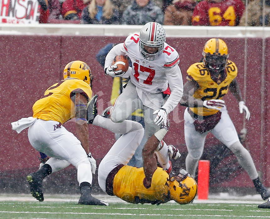Ohio State Buckeyes running back Jalin Marshall (17) jumps over Minnesota Golden Gophers defensive back Antonio Johnson (11) after a catch during the 1st quarter at TCF Bank Stadium in Minneapolis, Minn. on November 15, 2014.  (Dispatch photo by Kyle Robertson)