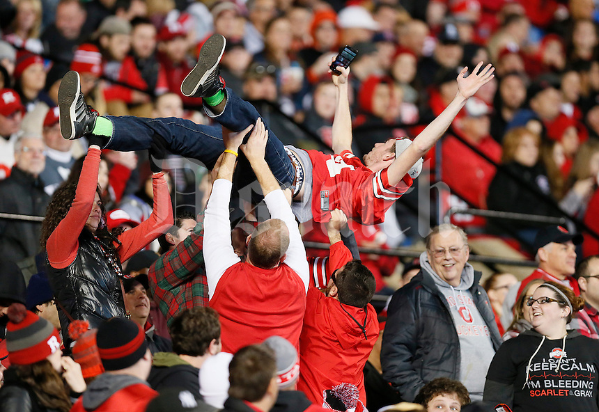 Ohio State fans celebrate after a touchdown during the college football game between the Rutgers Scarlet Knights and the Ohio State Buckeyes at High Point Solutions Stadium in Piscataway, NJ, Saturday night, October 24, 2015. The Ohio State Buckeyes defeated the Rutgers Scarlet Knights 49 - 7. (The Columbus Dispatch / Eamon Queeney)