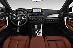 Stock photo of straight dashboard view of 2017 BMW 2-Series M240i 2 Door Coupe Dashboard
