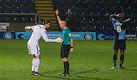 Referee Andy Davies shows Goalkeeper Matt Ingram of Wycombe Wanderers a red card meaning he will miss the Aston Villa FA Cup fixture during the Sky Bet League 2 match between Wycombe Wanderers and Morecambe at Adams Park, High Wycombe, England on 2 January 2016. Photo by Kevin Prescod / PRiME Media Images