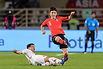 Hwang Inbeom of South Korea (R) is tackled by Chi Zhongguo of China (L) during the AFC Asian Cup UAE 2019 Group C match between South Korea (KOR) and China (CHN)  at Al Nahyan Stadium on 16 January 2019 in Abu Dhabi, United Arab Emirates. Photo by Marcio Rodrigo Machado / Power Sport Images