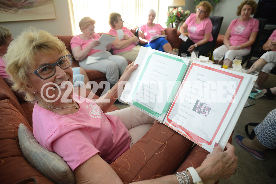 Carolyn King looks at a book showing the history of the group during a monthly meeting of the Neshaminy Book Club Thursday, September 28, 2017 in Lower Makefield, Pennsylvania. The group is celebrating their 30th Anniversary and originally consisted of teachers from Pearl buck Elementary School.(Photo by William Thomas Cain)