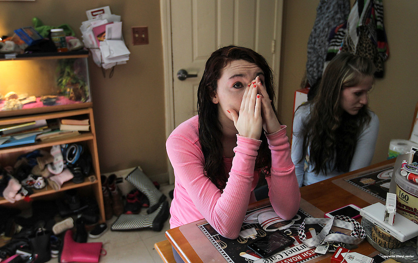 Bennington, VT -  Thursday, Jan. 30, 2014:   Recovering addict Hailey Clark, 20, left, weeps as she talks about losing custody of her baby.  Clark's mother now has the infant. Clark was one of many people arrested in the State's largest drug sweep.  Clark lives with friend and fellow recovering addict Stacey Brandmeyer, right, 22, in a public housing apartment.<br />   <br /> Gov. Peter Shumlin devoted his entire state of the state address in January to what he called a &quot;full-blown heroin crisis&quot; in Vermont, where twice as many people died of heroin overdoses in 2012 as in the year before. Mr. Shumlin's address focused new attention on the problem, which has hit every corner of the state.  <br /> <br /> CREDIT: Cheryl Senter for The New York Times