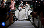 Sanya Richards and Aaron Ross jump the broom, a Jamaican tradition, during their wedding. Olympic gold medalist, Sanya Richards, and New York Giants cornerback, Aaron Ross, wed at the Hyde Park Baptist in Austin, Texas on Friday, February 26, 2010...