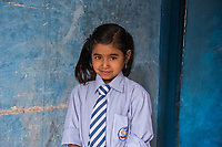 Nepal, Kathmandu, Nag Pokhari. Laxmi was helped by the Nepal Youth Foundation and fed when she was younger. Ten years old. Model released.