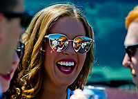 LEXINGTON, KENTUCKY - APRIL 08: A woman shares a laugh with friends on The Hill on Blue Grass Stakes Day at Keeneland Race Course on April 8, 2017 in Lexington, Kentucky. (Photo by Scott Serio/Eclipse Sportswire/Getty Images)