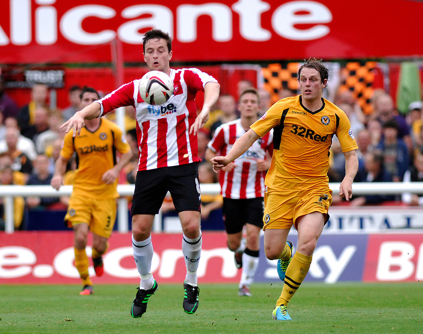Exeter City's Matt Oakley battles with Newport County's Adam Chapman<br /> <br /> Photo by Ashley Crowden/CameraSport<br /> <br /> Football - The Football League Sky Bet League Two - Exeter City v Newport County - Saturday 21st September 2013 - St James Park - Exeter<br /> <br /> &copy; CameraSport - 43 Linden Ave. Countesthorpe. Leicester. England. LE8 5PG - Tel: +44 (0) 116 277 4147 - admin@camerasport.com - www.camerasport.com