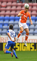 Blackpool's Will Aimson out jumps Wigan Athletic's Jordan Flores<br /> <br /> Photographer Dave Howarth/CameraSport<br /> <br /> The Carabao Cup - Wigan Athletic v Blackpool - Tuesday 8th August 2017 - DW Stadium - Wigan<br />  <br /> World Copyright &copy; 2017 CameraSport. All rights reserved. 43 Linden Ave. Countesthorpe. Leicester. England. LE8 5PG - Tel: +44 (0) 116 277 4147 - admin@camerasport.com - www.camerasport.com