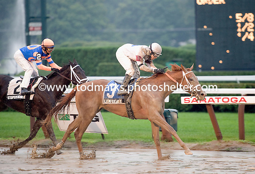 Le Mi Geaux wins the Schuylerville for 2-year-old fillies over the slop on opening day.