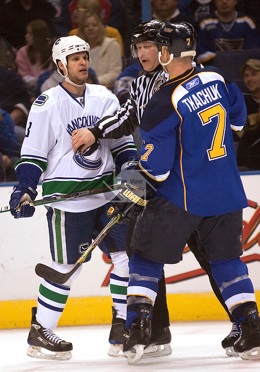 April 19 2009      A referee steps in between Canucks player Kevin Bieksa (left) and Blues player Keith Tkachuk to head off an altercation in the first period.    The St. Louis Blues hosted the Vancouver Canucks in the third playoff game between the two teams on Sunday April 19, 2009 at the Scottrade Center in downtown St. Louis, MO.  The Blues entered the game down 2-0 in the best of seven series.  ..            *******EDITORIAL USE ONLY*******