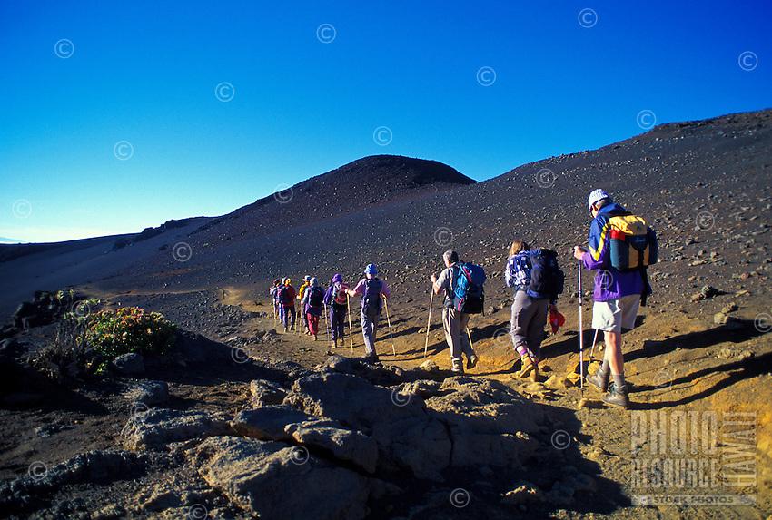 A German tour group begins a hike on Sliding Sands Trail just after sunrise in Haleakala National Park.