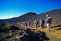 A German tour group begins a hike on Sliding Sands Trail just after sunrise in Haleakala National Park.