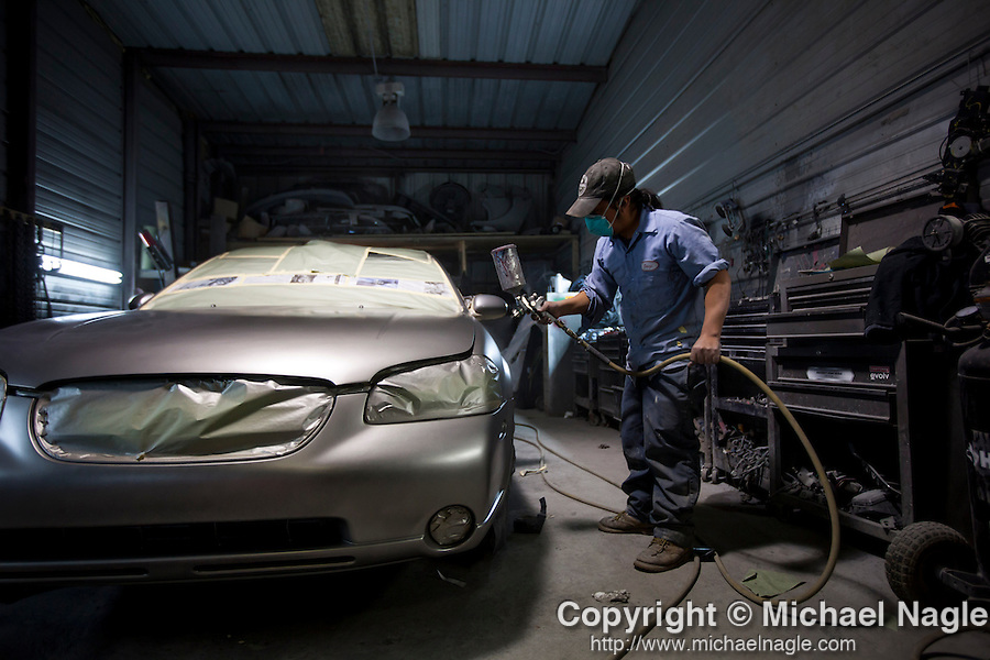 QUEENS, NY -- OCTOBER 25, 2013:   A man paints a car in Willets Point on October 25, 2013 in Queens, NY.  PHOTOGRAPH  BY MICHAEL NAGLE FOR THE NEW YORK TIMES