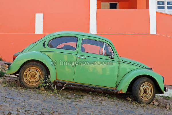 Brazil, Bahia, Lencois (Parque Nacional de Chapada Diamantina): Old historic Volkswagen Beetle parked in one of Lencois' cobblestone roads. --- No releases available. Automotive trademarks are the property of the trademark holder, authorization may be needed for some uses.