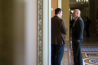 Reporter for the New York Times, Jonathan Martin, left, speaks with White House Legislative Director Marc Short, right, near the Senate Chamber in the US Capitol in Washington, D.C. on Friday, December 1, 2017. Photo Credit: Alex Edelman/CNP/AdMedia