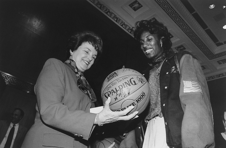 Sen. Dianne Feinstein, D-Calif., is presented by a ball by USA Basketball Women's National team member Lisa Leslie at a reception honoring the team, in June 1995. (Photo by Gigi Goshko/CQ Roll Call via Getty Images)