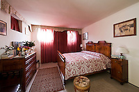 One of the guest bedrooms at Villa Barberina furnished with antique furniture