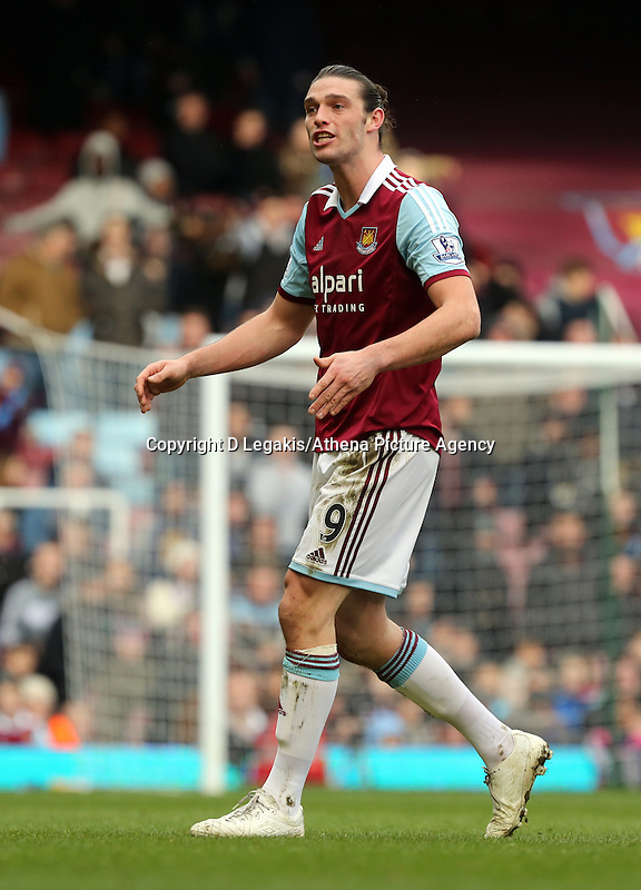Pictured: Andy Carroll of West Ham is getting off the pitch protesting having been shown a red card by match referee Howard Webb for his header challenge against Chico Flores of Swansea. 01 February 2014<br /> Re: Barclay's Premier League, West Ham United v Swansea City FC at Boleyn Ground, London.