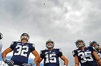 Sept. 19, 2009; Provo, UT, USA; BYU Cougars tight end (32) Dennis Pitta , quarterback (15) Max Hall and linebacker (35) Mike Bauman look up at the coin during the coin toss prior to the game against the Florida State Seminoles at LaVell Edwards Stadium. Florida State defeated BYU 54-28. Mandatory Credit: Mark J. Rebilas-