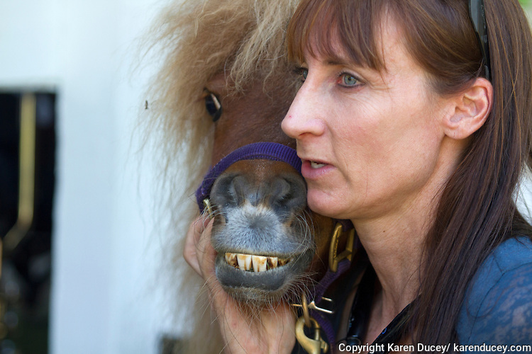 Veterinarian Dana Bridges Westerman and dwarf miniature horse, Tiny Bubbles, visit with residents at the Park Ridge Skilled Nursing Center in Shoreline, Washington on July 10, 2014. Westerman from Professional Equine Therapeutic arranges the therapy visit every year.