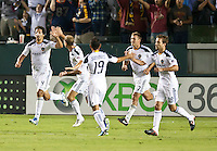 CARSON, CA – August 6, 2011: LA Galaxy defender Omar Gonazalez (4) being congratulated by teammate Gregg Berhalter (3) during the match between LA Galaxy and FC Dallas at the Home Depot Center in Carson, California. Final score LA Galaxy 3, FC Dallas 1.
