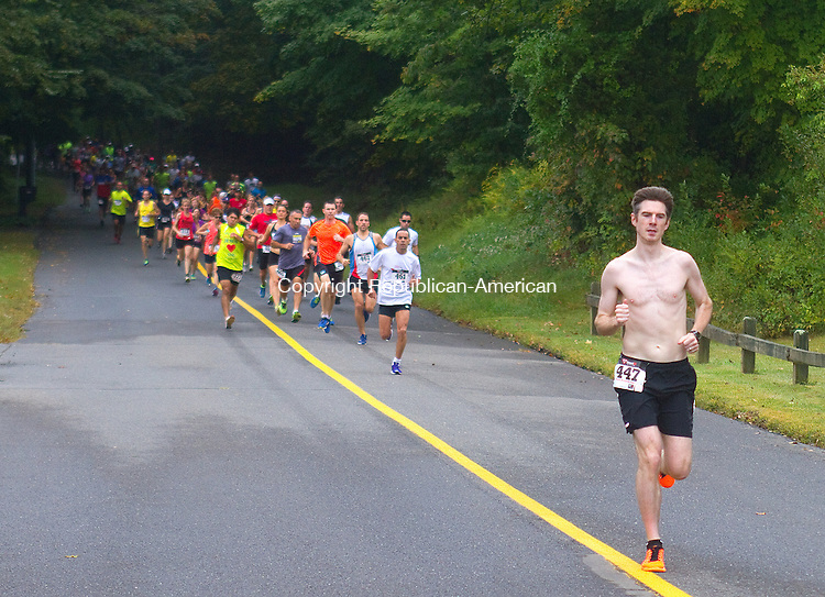 SOUTHBURY, CT.- 21 SEPTEMBER 2014 - 092114JW06. - Pat Dennen of Middlebury takes an early lead at the start in Southbury's 25th Annual Fall Classic 10K Road Race Sunday morning at Community House Park.<br /> Jonathan Wilcox Republican-American