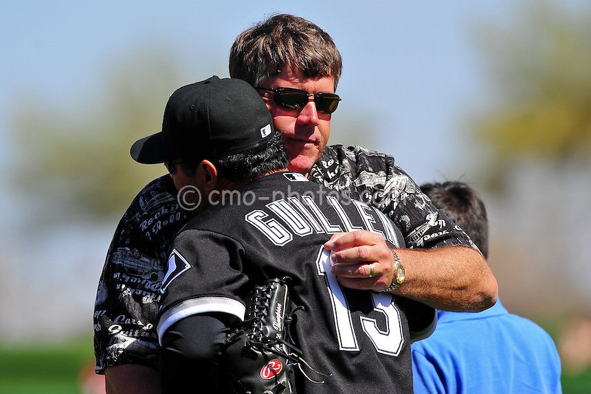 Mar 7, 2011; Tucson, AZ, USA; John Green hugs Chicago White Sox manager Ozzie Guillen prior to a charity exhibition game at the Kino Sports Complex to benefit the Christina-Taylor Green foundation.  John is the father of Christina-Taylor who was the 9-year-old girl that was shot and killed during the January assassination attempt on Rep.  Gabrielle Giffords.