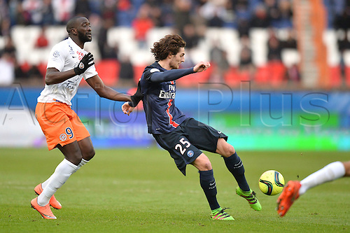 05.03.2016. Paris, France. French League 1 football. Paris St Germain versus Montpellier.  ADRIEN RABIOT (psg) shoots under pressure from Mustapha YATABARE (mon)