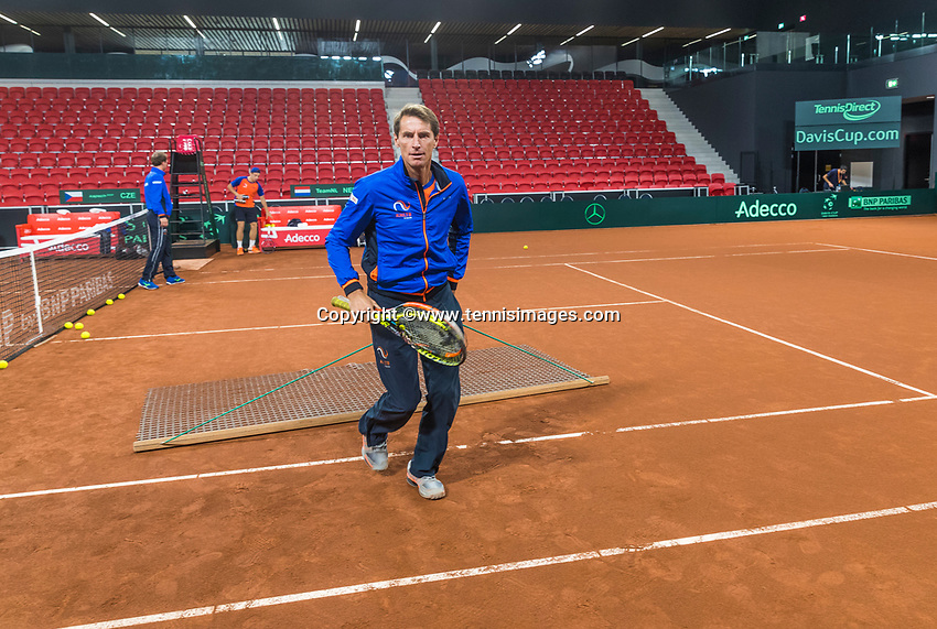 The Hague, The Netherlands, September 13, 2017,  Sportcampus , Davis Cup Netherlands - Chech Republic, Training Dutch team, captain Paul Haarhuis is tweeping the court<br /> Photo: Tennisimages/Henk Koster