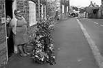 Abbotsbury Garland Day, Dorset, England 1975<br /> <br /> Mrs Julia Ellen Arnold affectionately known as Nell Arnold and her neighbour Mrs Molly Cribb 45 West Street Abbotsbury. Nell learnt the tradition of garland making from her mother Rosetta Roper.