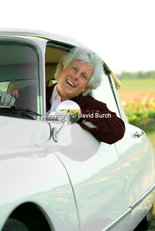 Man in car, smiling, portrait