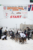 Jessica Hendricks and team leave the ceremonial start line at 4th Avenue and D street in downtown Anchorage during the 2013 Iditarod race. Photo by Jim R. Kohl/IditarodPhotos.com