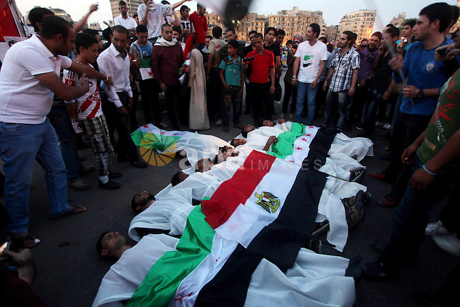 Protesters show solidarity with victims of massacre of Houla during a protest in front of the Syrian embassy in Cairo, Egypt, 31 May 2012. A massacre was reported in the central Syrian city of Houla over the weekend, however the government in Damascus denied responsibility. UN observers confirmed on the weekend after visiting Houla that 108 people had died in the town - about one-third of them children - in what activists said was shelling by government forces. Photo by Ashraf Amra. Photo by Ashraf Amra