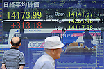 September 9th, 2013 : Tokyo, Japan - A man, left, looked at a stock quotation board at Yaesu, Chuo, Tokyo, Japan on September 9, 2013. Nikkei Stock Average climbed due to several reasons, such as Tokyo that was selected to host the 2020 Olympics and Paralympics.  (Photo by Koichiro Suzuki/AFLO)
