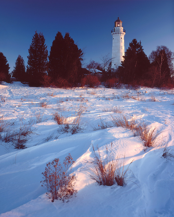 Sunrise light on Cana Island Lighthouse on Lake Michigan; Door County, WI