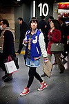 Tokyo, Shinjuku, February 23 2010 - A Japanese woman commuting in the Shinjuku train station.