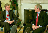 Washington, D.C. - December 4, 2006 -- United States President George W. Bush meets United Nations Ambassador John Bolton in the Oval Office of The White House in Washington, D.C. on Monday, December 4, 2006.  The President reluctantly accepted Bolton's resignation earlier in the day.<br /> Credit: Ron Sachs / CNP