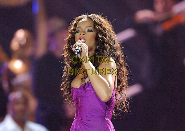 RIHANNA .World Music Awards 2006.Earls Court, London England..November 15th, 2006.half length live gig performance music concert purple fuschia dress singing.CAP/BEL.©Tom Belcher/Capital Pictures.