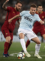 Calcio, Serie A: S.S. Lazio - A.S. Roma, stadio Olimpico, Roma, 15 aprile 2018. <br /> Lazio's Ciro Immobile (r) in action with Roma's captain Daniele De Rossi (l) during the Italian Serie A football match between S.S. Lazio and A.S. Roma at Rome's Olympic stadium, Rome on April 15, 2018.<br /> UPDATE IMAGES PRESS/Isabella Bonotto