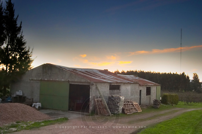 Sunset over the winery building. Bodega Carlos Pizzorno Winery, Canelon Chico, Canelones, Uruguay, South America