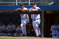 Danville Braves hitting coach Barbaro Garbey (left) and manager Barrett Kleinknecht (right) watch the action from the dugout during the game against the Bristol Pirates at American Legion Post 325 Field on July 1, 2018 in Danville, Virginia. The Braves defeated the Pirates 3-2 in 10 innings. (Brian Westerholt/Four Seam Images)