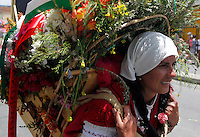 MEDELLIN, COL AUG 07. A woman wears a flower arrangement in the parade Silleteros 59th in Medellin,  Colombia, on August 7, 2016. (Photo by Fredy Builes / VIEWpress)