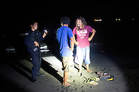 Maximiliano Gutierrez Gutierrez and friend are poachers being questioned by the police.  Maximilliano localy known as ¨Gutti¨shared  the eggs from a nest with Jairo the night he was killed. Jairo told Vanessa that if anything was to happen to him to ask Gutti. On patrol with police and conservationists to protect Turtles laying eggs from armed and dangerous poachers, some who are thought to have recently murdered conservationist Jairo Mora.  Costa Rica Wildlife Sanctuary run by Vanessa Lizano and her family. Moin, Limon, Costa Rica.